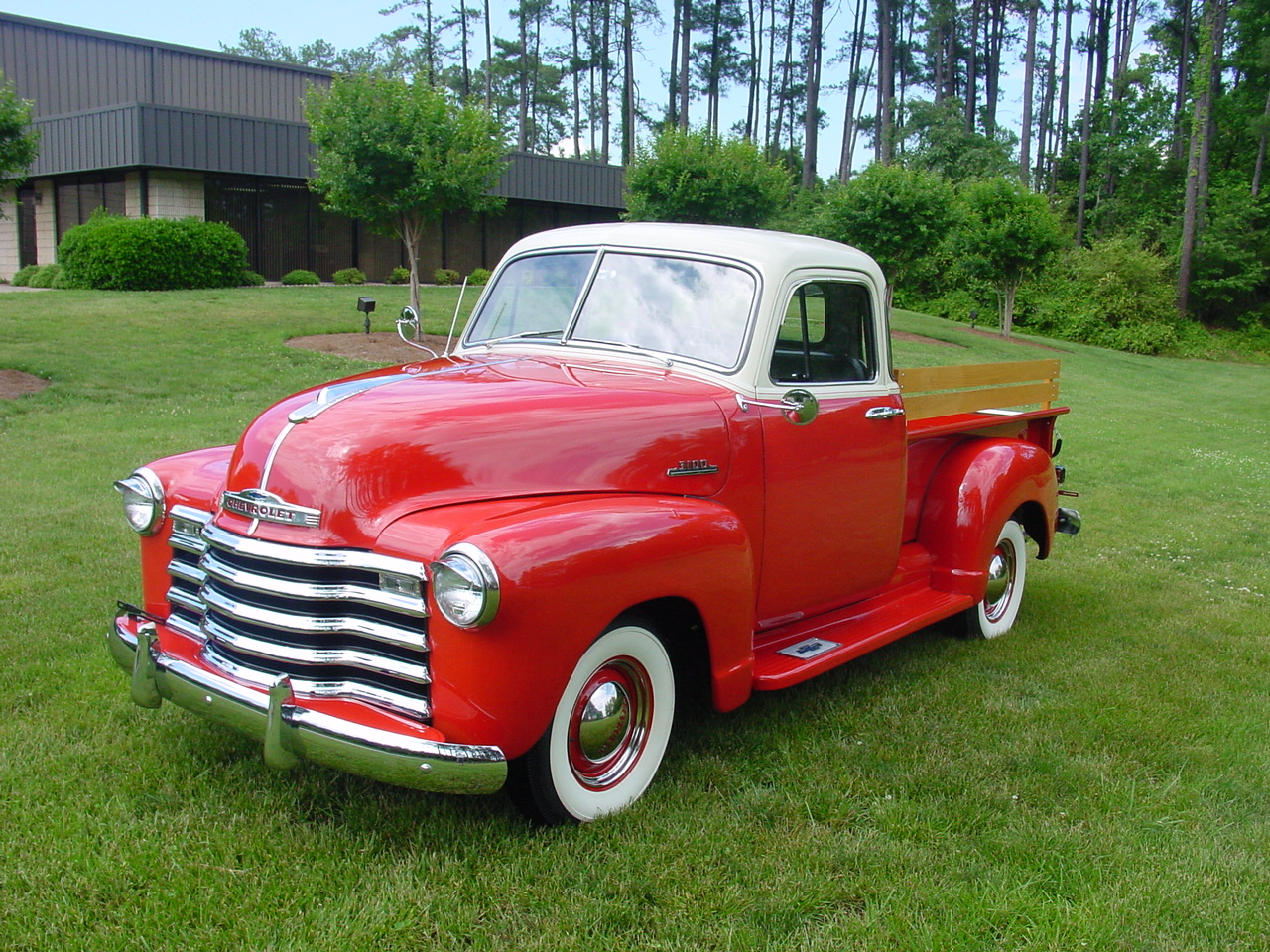 Picture of red 1950 Model of pickup truck-Chevrolet 3100